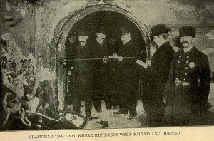 3. Officials measuring the exit where hundreds were killed and burned. Many of the exits opened inward, or were simply locked.